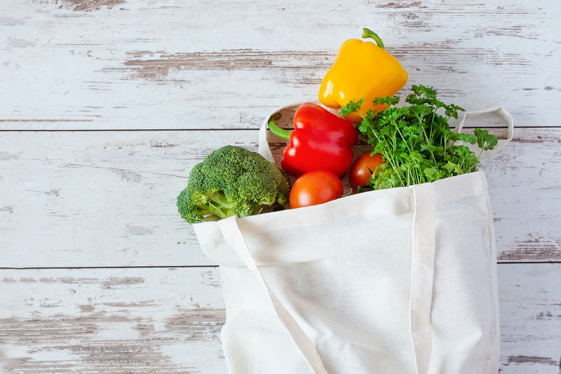 Cotton eco-friendly bag for grocery with vegetables